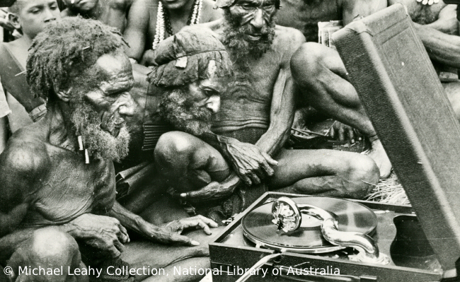 Papuans looking at first gramaphone, Mount Hagen, Papua New Guinea, 1933
